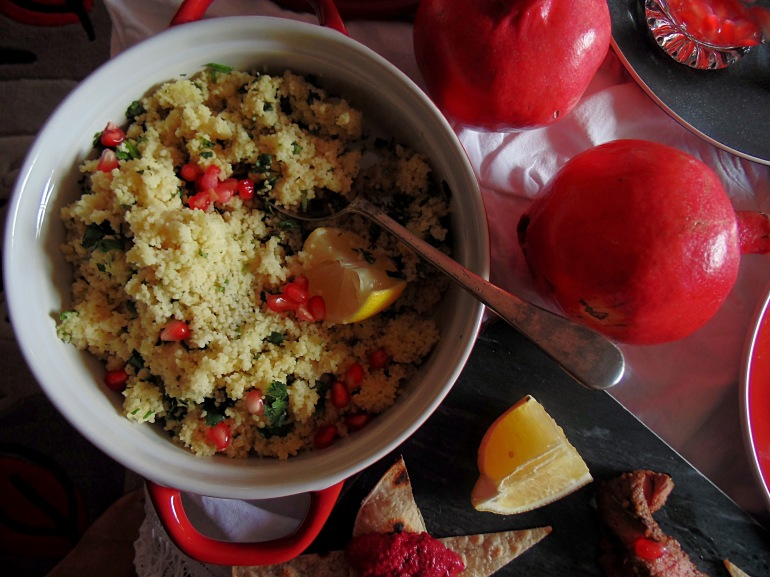 Jazz up cous cous with ruby red pomegranate seeds.