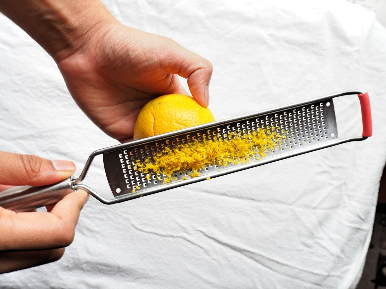 Zest oranges with the blades facing down.