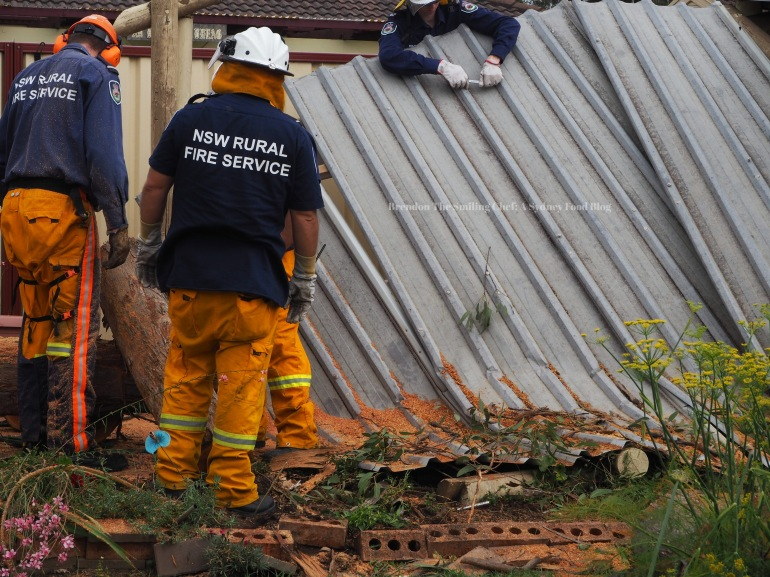 The RFS members clearing up the damage.